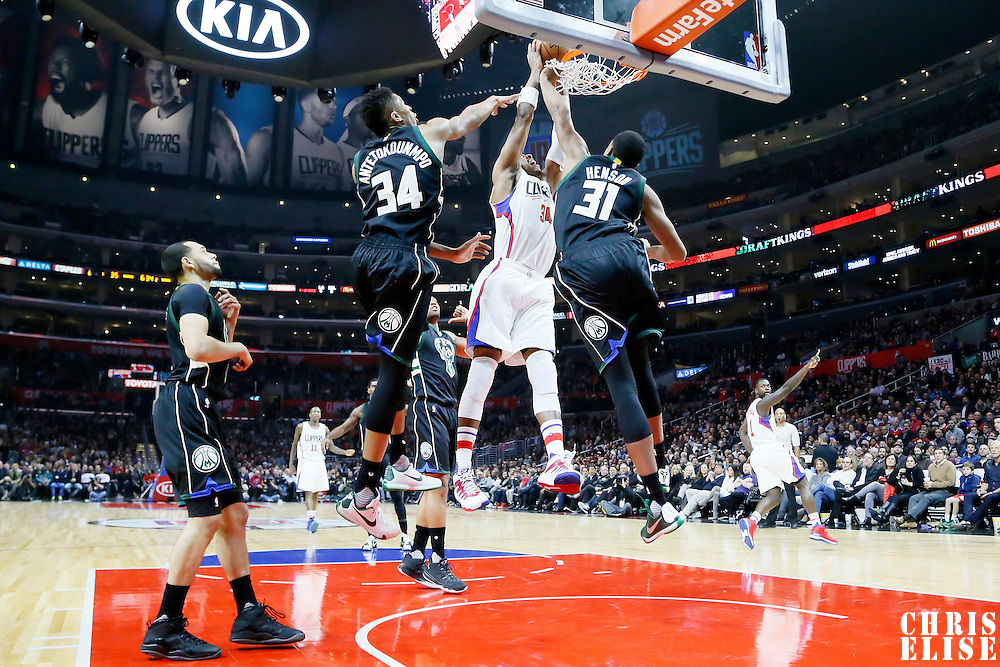 16 December 2015: Los Angeles Clippers forward Paul Pierce (34) goes for the dunk over Milwaukee Bucks forward John Henson (31) and Milwaukee Bucks forward Giannis Antetokounmpo (34) during the Los Angeles Clippers 103-90 victory over the Milwaukee Bucks, at the Staples Center, Los Angeles, California, USA.