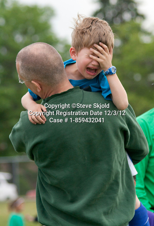Crying young soccer player carried off field after a sports injury. Carondelet Field by Expo School St Paul Minnesota MN USA