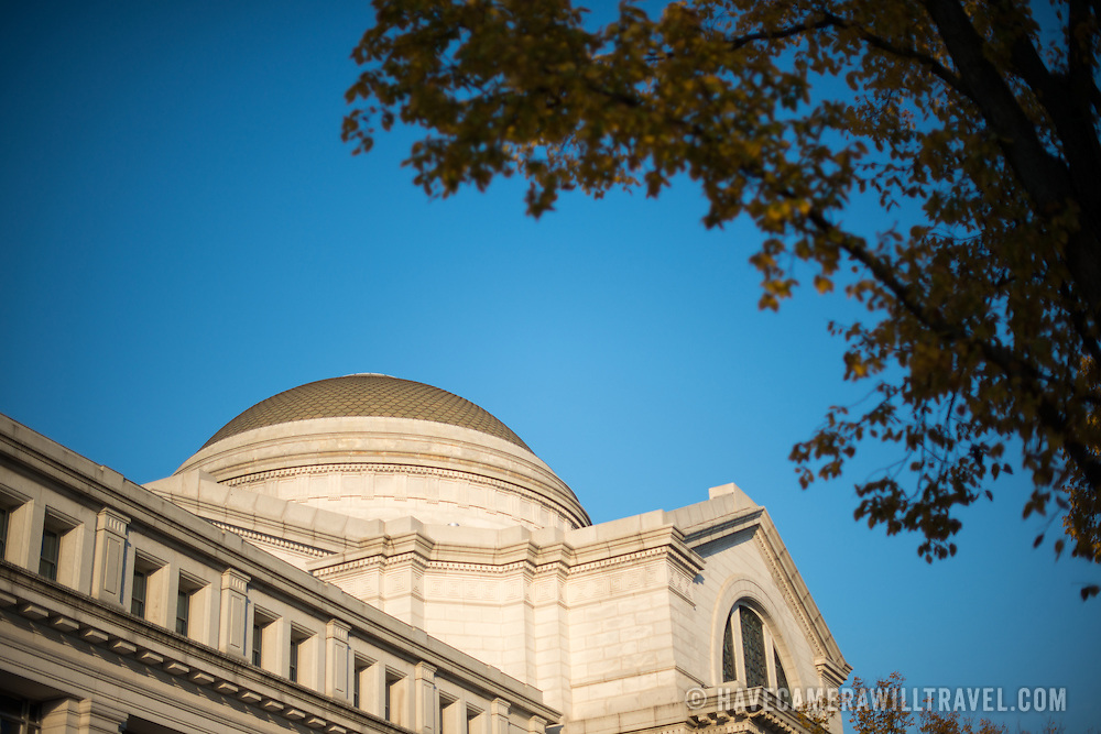 The dome of the Smithsonian Institution's National Museum of Natural History in Washington DC set against a clear blue sky.