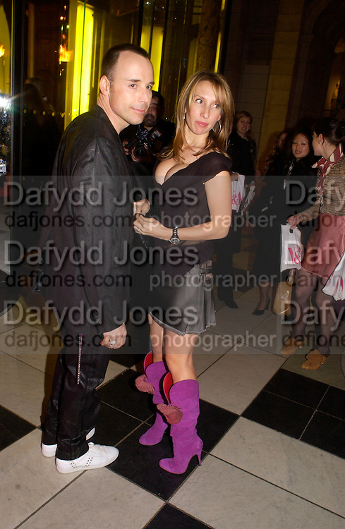 David Furnish and Sam Taylor Wood, Opening of Vivienne Weatwood exhibition. V. & A. 30 March 2004. ONE TIME USE ONLY - DO NOT ARCHIVE  © Copyright Photograph by Dafydd Jones 66 Stockwell Park Rd. London SW9 0DA Tel 020 7733 0108 www.dafjones.com