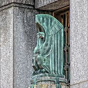 Art Deco American Eagle Sculpture by Oscar Bach in front outside of the Departments of Health Hospitals and Sanitation Building in lower Manhattan in New York City.<br />