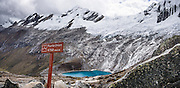 Day 2 of 10: From Punta Union (a pass at 15,584 feet or 4750 m), see Nevado Rinrijirca (5810 m) above Lago Taullicocha. Trek 10 days around Alpamayo, in Huascaran National Park (UNESCO World Heritage Site), Cordillera Blanca, Andes Mountains, Huaraz, Peru, South America. This panorama was stitched from 2 overlapping photos.