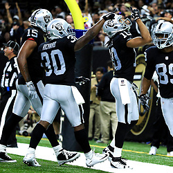 Sep 11, 2016; New Orleans, LA, USA;  Oakland Raiders wide receiver Seth Roberts (10) celebrates with teammates after catching a touchdown against the New Orleans Saints during the fourth quarter of a game at the Mercedes-Benz Superdome. The Raiders defeated the Saints 35-34. Mandatory Credit: Derick E. Hingle-USA TODAY Sports