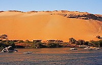 desert sand dune at sunset with blue sky on the shore of the river nile in egypt