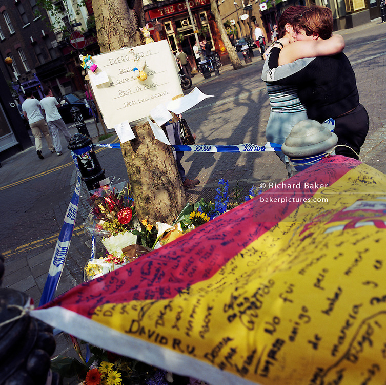 "A memorial has been placed where a young Spanish schoolboy boy called 'Diego' died at Seven Dials, Covent Garden, London, England, UK. If we drove past this place where someone's life ended, the victim would just be an anonymous statistic but flowers are left to die too and touching poems and dedications are written by family and loved-ones. One reads: ""?Diego our friend, we are sorry you had to die like this.? ?School will never be the same without you.? From a project about makeshift shrines: ?Britons have long installed memorials in the landscape: Statues and monuments to war heroes, Princesses and the socially privileged. But nowadays we lay wreaths to those who die suddenly - ordinary folk killed as pedestrians, as drivers or by alcohol, all celebrated on our roadsides and in cities with simple, haunting roadside remberences."