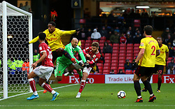 Heurelho Gomes of Watford punches the ball clear of Matty Taylor of Bristol City - Mandatory by-line: Robbie Stephenson/JMP - 06/01/2018 - FOOTBALL - Vicarage Road - Watford, England - Watford v Bristol City - Emirates FA Cup third round proper