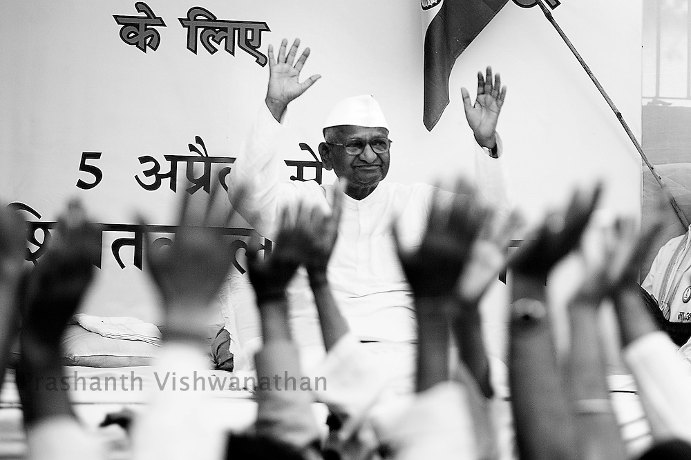 Social activist Anna Hazare reacts to his supporters shouting slogans in New Delhi, India, on Thursday, April 7, 2011. Hazare has vowed to fast to the death to rid India of the corruption he says is its biggest curse. Photographer: Prashanth Vishwanathan