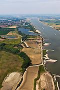 Nederland, Gelderland, Gemeente Druten, 08-07-2010; Afferdense en Deestse Waarden, uiterwaarden van de Waal met aan de oevers van de rivier de voormalige steenfabriek Turkswaard. De uitwaarden worden gedeeltelijk afgegraven (ontgronden) en er wordt een meestromende nevengeul aangelegd. Onderdeel van het programma Waalweelde (Ruimte voor de Rivier). De bestaande waterpartijen zijn kleiputten. .Floodplains of the Waal. The plains will be partially excavated and a side channel will be constructed..luchtfoto (toeslag), aerial photo (additional fee required).foto/photo Siebe Swart