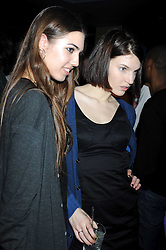 Left to right, AMBER LE BON and BEN GRIMES at the launch party of the Nokia 5800 phone held at PUNK 14 Soho Street, London W1 on 27th January 2009.