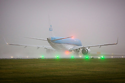 © Licensed to London News Pictures. 28/11/2018. Leeds UK. A KLM aircraft is barely visible through thick fog this morning at Englands highest airport, Leeds Bradford International. Photo credit: Andrew McCaren/LNP