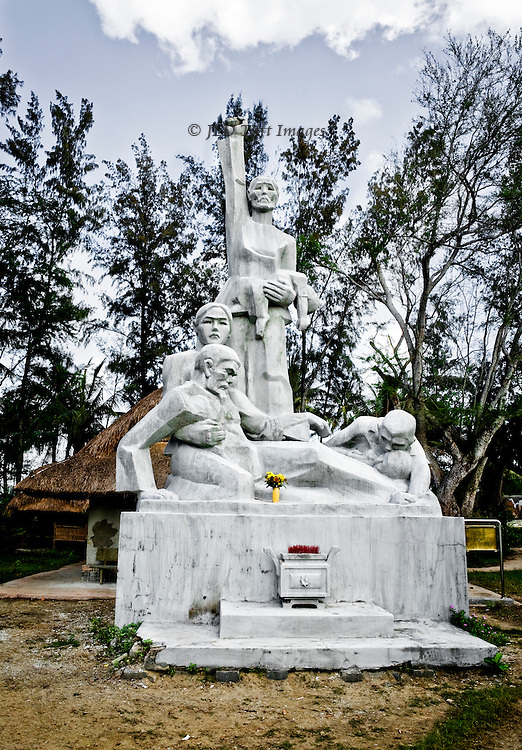 Memorial statue of a woman holding a dead baby, four wounded men at her feet, dedicated 1998 at the My Lai Memorial Park.