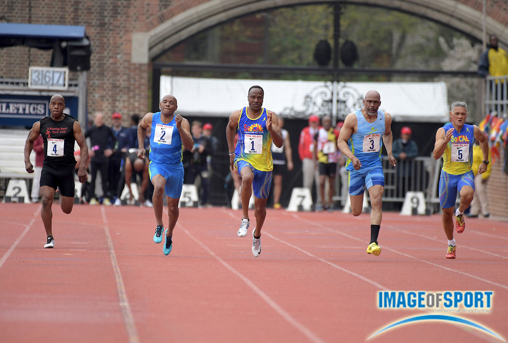 Apr 27, 2018; Philadelphia, PA, USA; Willie Gault (1) wins the Masters age 55 and older 100m in 11.84 during the 124th Penn Relays at Franklin Field. From left: Kerry Sloan (4), Don McGee (2), Gault, Lonnie Hooker (3) and Robert Foster (5).