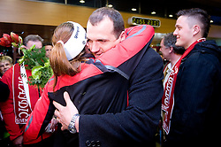 Slovenian athlete Petra Majdic celebrates with her brother when she arrived home with cristal globus at the end of the nordic season 2008/2009, on March 23, 2009, at airport Jozeta Pucnika, Brnik, Slovenia. (Photo by Vid Ponikvar / Sportida)