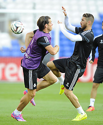 Real Madrid's Gareth Bale battles for the ball with Real Madrid's Sergio Ramos - Photo mandatory by-line: Joe Meredith/JMP - Mobile: 07966 386802 11/08/2014 - SPORT - FOOTBALL - Cardiff - Cardiff City Stadium - Real Madrid v Sevilla - UEFA Super Cup - Press Conference and Open Training session