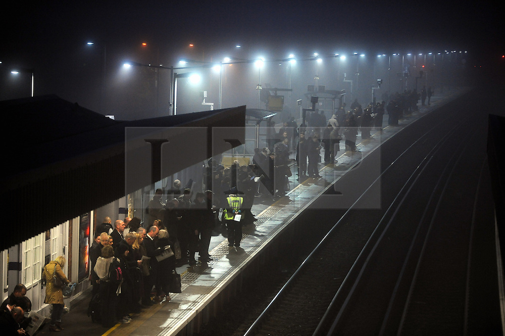 © Licensed to London News Pictures. 11/12/2013<br /> Foggy weather.<br /> A Foggy cold morning as commuters make their way to work in London from Pettswood Station,Pettswood,Kent.<br /> Photo credit :Grant Falvey/LNP
