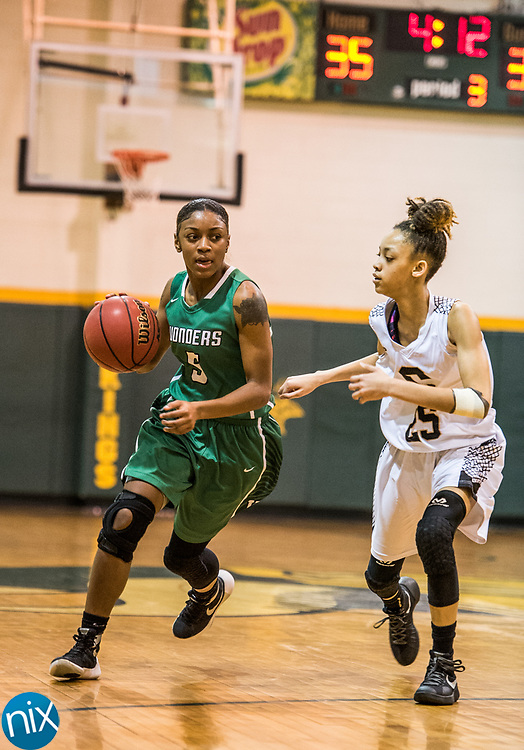 Kannapolis' Akeena Maxwell (5) brings the ball down against Concord during a South Piedmont Conference basketball game Saturday night at Central Cabarrus High School.