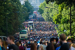 A view of the party goers in the streets at the 2013 Notting Hill Carnival in West London, United Kingdom. Monday, 26th August 2013. Picture by Nils Jorgensen / i-Images