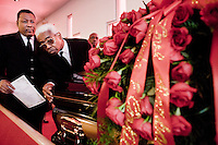 Harlem, New York, USA - April 2. Funeral home director Isaiah Owens and his limousine driver bring the casket of Jacqueline Gould, 45, outside the Healing From Heaven Temple Church, where the funeral service took place on April 2, 2008 in Harlem, New York, USA. Jacqueline Gould was an administrator at the Harlem Hospital.
