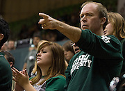 Tim May of Dublin, Ohio points at a Cardinal player as his daughter Kelly May, a sophomore broadcast journalist, applauds a foul call on Saturday, January 26, 2008 in the Convocation Center. The Ohio University Bobcats beat the Ball State University Cardinals 61-59 with a dramatic comeback win on Dads weekend...Dad's weekend: Basketball game at Convo. : Diego James Robles