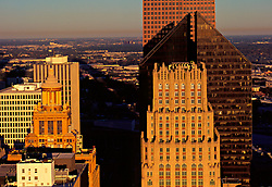 Aerial cityscape of Houston's downtown skyline featuring the JPMorgan Chase, Niels Esperson, and Pennzoil Place buildings.