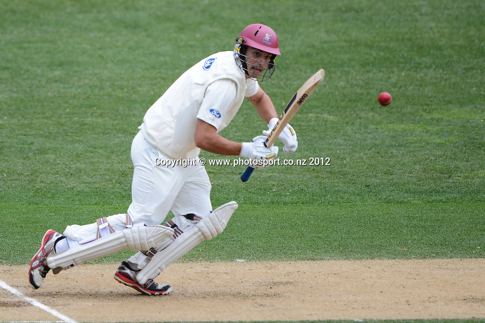 Daryl Mitchell batting for Northern. Plunket Shield Cricket, Auckland Aces v Northern Knights at Eden Park Outer Oval. Monday 12 November 2012. Photo: Andrew Cornaga/Photosport.co.nz