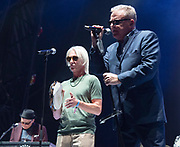 """Madness with Paul Weller<br /> perform live at the House of Common festival, Clapham Common, London, Great Britain<br /> 26th August 2019<br /> <br /> Madness<br /> Graham """"Suggs"""" McPherson<br /> Chris Foreman<br /> Mike Barson<br /> Lee Thompson<br /> Dan Woodgate<br /> Mark Bedford<br /> <br /> <br /> Photograph by Elliott Franks"""