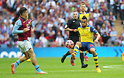 Arsenal's Francis Coquelin on the ball during the The FA Cup match between Arsenal and Aston Villa at Wembley Stadium, London, England on 30 May 2015. Photo by Phil Duncan.