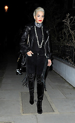 Singer Rita Ora wearing a leather bikers jacket, sheer top, black velvet trousers and knee high boots out in south west London, UK. 06/03/2015<br />BYLINE MUST READ : STARS/GOTCHAIMAGES.COM<br /><br />Copyright by © Gotcha Images Ltd. All rights reserved.<br />Usage of this image is conditional upon the acceptance <br />of Gotcha Images Ltd, terms and conditions available at<br />www.gotchaimages.com