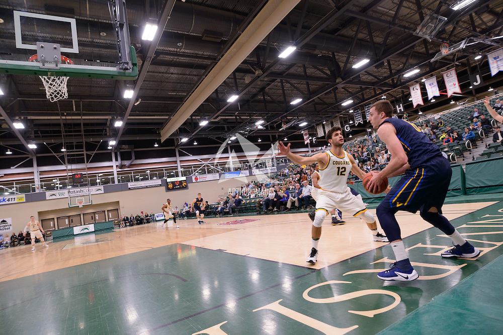 3rd year forward Kornel Tokolyi (12) of the Regina Cougars in action during the home opener  on November  4 at Centre for Kinesiology, Health and Sport. Credit: /Arthur Images