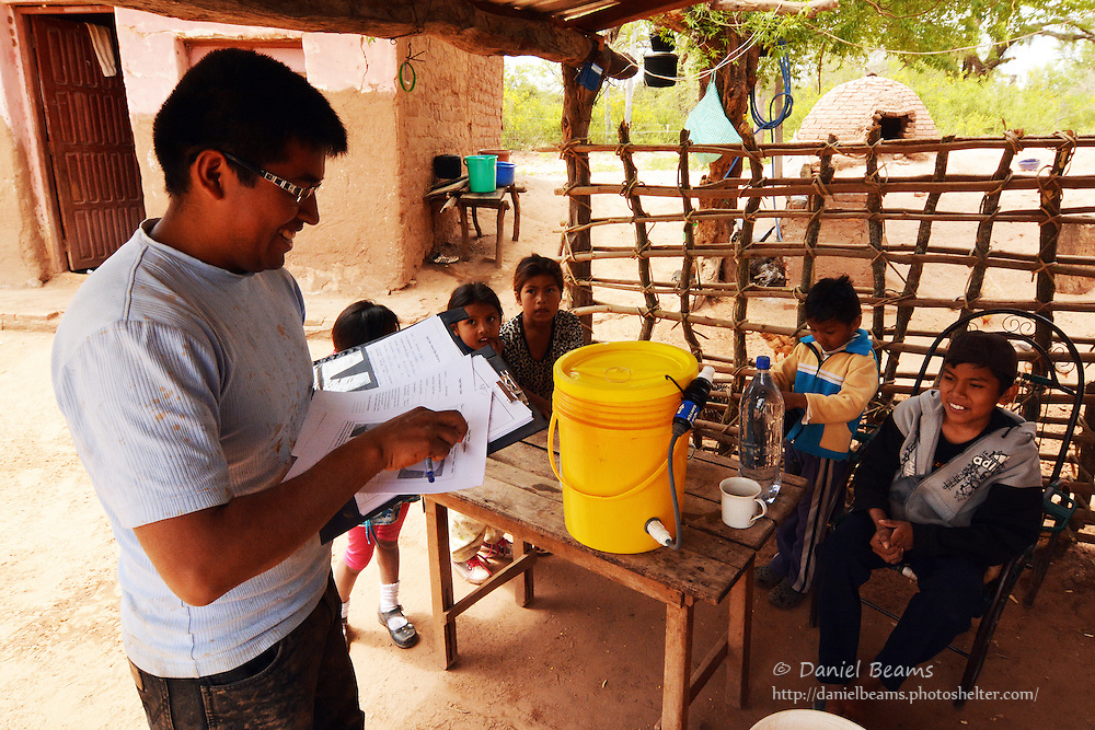 Demonstrating the Sawyer water filter in Isosog, Santa Cruz, Bolivia