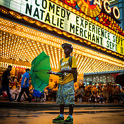 Keeland Jordan, 9, and other fans watch on State Street as Jackie Robinson West plays in the U.S. Championship of the Little League World Series on Saturday, Aug. 23, 2014 during a watch party in front of the Chicago Theatre. (Brian Cassella/Chicago Tribune) B583959904Z.1 <br /> ....OUTSIDE TRIBUNE CO.- NO MAGS,  NO SALES, NO INTERNET, NO TV, CHICAGO OUT, NO DIGITAL MANIPULATION...