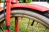 Close up of a classic single speed bicycle wheel and tire.