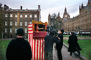 UK. London. The Village Green: From Blair to Brexit.<br /> A story on the relationship between the Media, Politicians and the public as they come together on College Green, a small patch of land next to The Houses of Parliament in Westminster. <br /> Photo shows a TV crew that has set up a Punch & Judy show on the Green after a reference to 'Punch & Judy politics' was made in The House of Commons.<br /> Photo©Steve Forrest/Workers' Photos
