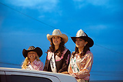 PRCA Rodeo queens riding in the back of a pickup truck at the NW Montana Fair.