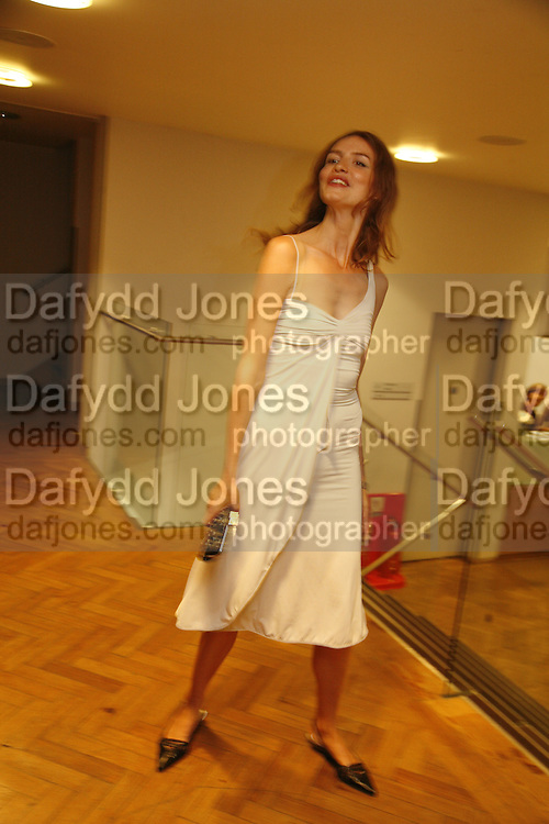 Saffron Burrows. Sadler's Wells Celebrates. Benefit evening for Sadler's Wells hosted by Angela Bernstein and Alistair Spalding. The Royal Horticultural Halls. London. 25 September 2006. -DO NOT ARCHIVE-© Copyright Photograph by Dafydd Jones 66 Stockwell Park Rd. London SW9 0DA Tel 020 7733 0108 www.dafjones.com