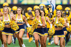 Oct 1, 2016; Morgantown, WV, USA; The West Virginia Mountaineers cheerleaders lead the West Virginia Mountaineers onto the field prior to their game against the Kansas State Wildcats at Milan Puskar Stadium. Mandatory Credit: Ben Queen-USA TODAY Sports