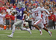 Running back Alex Barnes #34 of the Kansas State Wildcats rushes 75-yards for a touchdown past defensive back Parnell Motley #11 of the Oklahoma Sooners during the first half at Bill Snyder Family Stadium in Manhattan, Kansas.