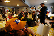 Edward Lewis of Council Bluffs listens as Republican presidential candidate Ted Cruz speaks Saturday, Nov. 28, 2015, during a campaign stop at the Tiger Den restaurant in Lenox, Iowa.
