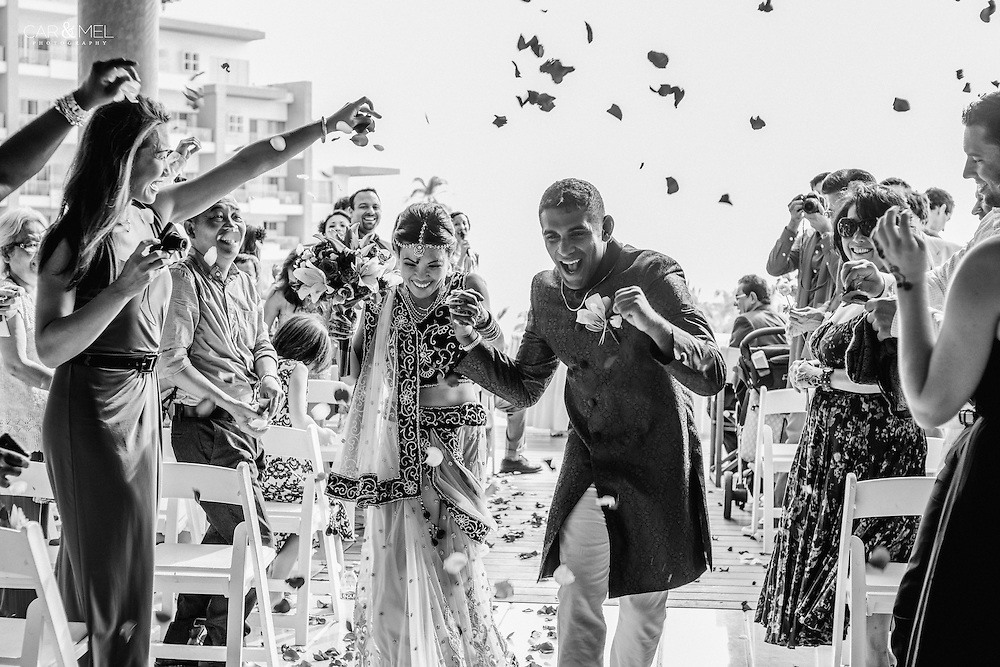 Van and Uday's happy walk after their ceremony at the Now Amber Resort in Puerto Vallarta. Photo by Melissa Suneson.