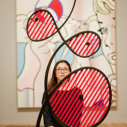 London, UK - 18 February 2013: a Tate employee stands in front of 'Galatea' during the  'Lichtenstein: A Retrospective' exhibition that opens at Tate Modern in London on the 21st of February. The exhibition is the first major Lichtenstein retrospective for twenty years, bringing together over 125 of the artist's most definitive paintings and sculptures. Built on new research and scholarship, the exhibition reassesses Lichtenstein's work and his enduring legacy.
