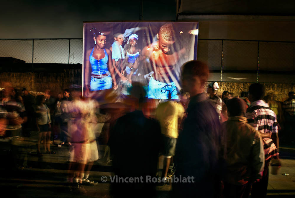 "Projection of the photographic series ""Rio Baile Funk"" during a Baile, here in the favela Boca do Mato, Northern area of Rio de Janeiro. After years documenting and photographing  the bailes funk, it seemed only fair to show this work where it actually took place.."