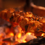 Paneer Tikka - A Delicious Grilled dish made of Paneer. Paneer is a firm Indian cheese which soaks up the flavour of the marinade and keeps its shape when cooked.
