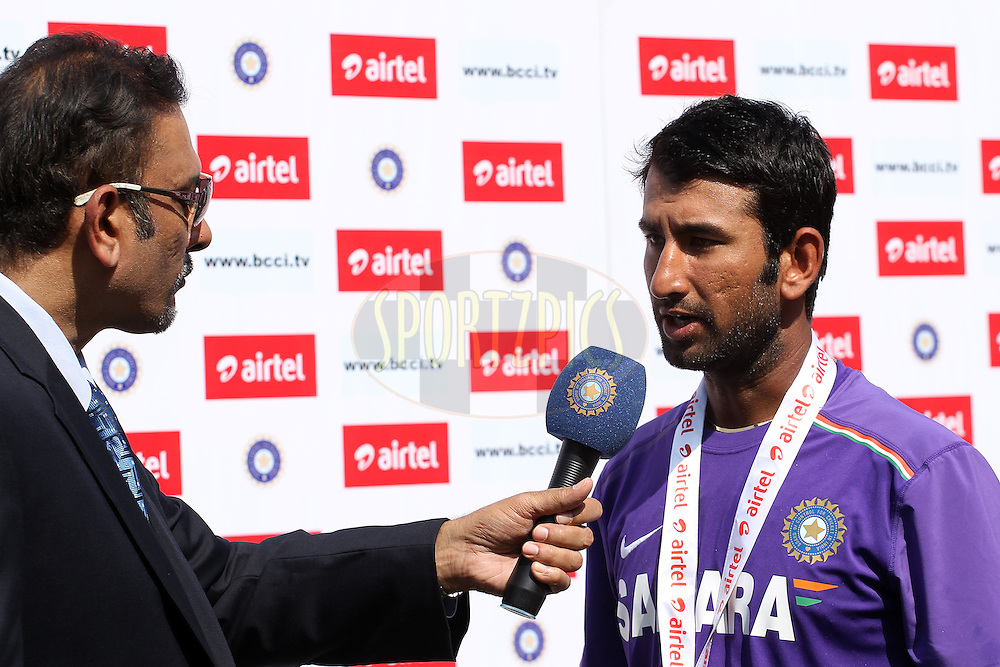 Cheteshwar Pujara of India is interviewed after receiving the man of the match award during day five of the 1st Airtel Test Match between India and England held at the Sadar Patel Stadium in Ahmedabad, Gujarat, India on the 19th November 2012...Photo by Ron Gaunt/ BCCI/ SPORTZPICS..Use of this image is subject to the terms and conditions as outlined by the BCCI. These terms can be found by following this link:..http://www.sportzpics.co.za/image/I0000SoRagM2cIEc