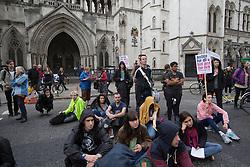 © licensed to London News Pictures. London, UK 05/10/2013. UK Uncut demonstrators protesting against cuts to legal aid outside the Royal Courts of Justice in central London on Saturday, 5 October 2013. Photo credit: Tolga Akmen/LNP