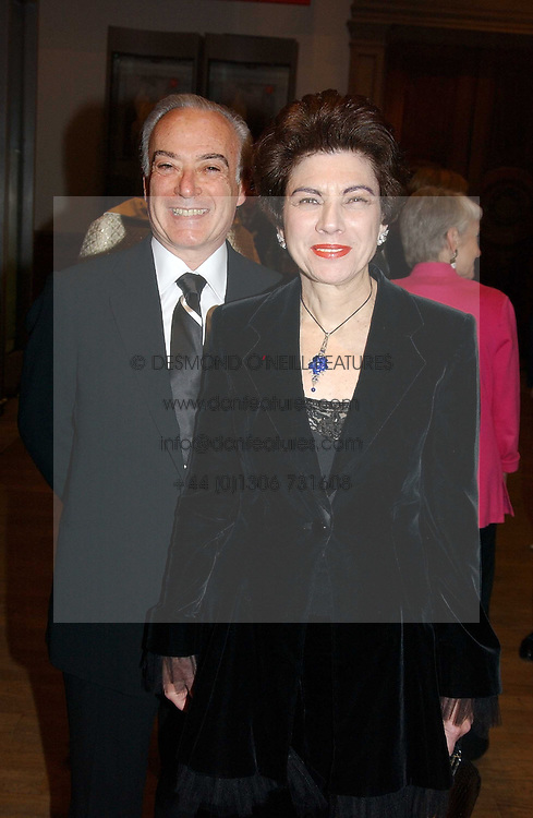 MR &amp; MRS IVOR GORDON he is the South African jeweller at an exhibition of art entitled 'Royal Academicians in China: 2003-2005' held at the Royal Academy of Arts, Burlington House, Piccadilly, London on 11th January 2005.<br />