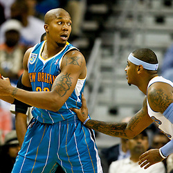 October 29, 2010; New Orleans, LA, USA; New Orleans Hornets power forward David West (30) is guarded by Denver Nuggets small forward Carmelo Anthony (15) during the first half at the New Orleans Arena. The Hornets defeated the Nuggets 101-95.  Mandatory Credit: Derick E. Hingle