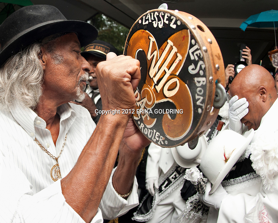 "NEW ORLEANS, LA - JULY 20:  Big Chief Alfred Doucette beats a tambourine at the funeral for ""Uncle"" Lionel Batiste, singer and bass drummer for Treme Brass Band, at the Mahalia Jackson Theater on July 20, 2012 in New Orleans, Louisiana. Batiste passed away July 8th at the age of 81.  (Photo by Erika Goldring/WireImage)"