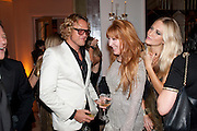 PETER DUNDAS; CHARLOTTE TILBURY; POPPY DELEVIGNE, Harper's Bazaar Women Of the Year Awards 2011. Claridges. Brook St. London. 8 November 2011. <br /> <br />  , -DO NOT ARCHIVE-© Copyright Photograph by Dafydd Jones. 248 Clapham Rd. London SW9 0PZ. Tel 0207 820 0771. www.dafjones.com.