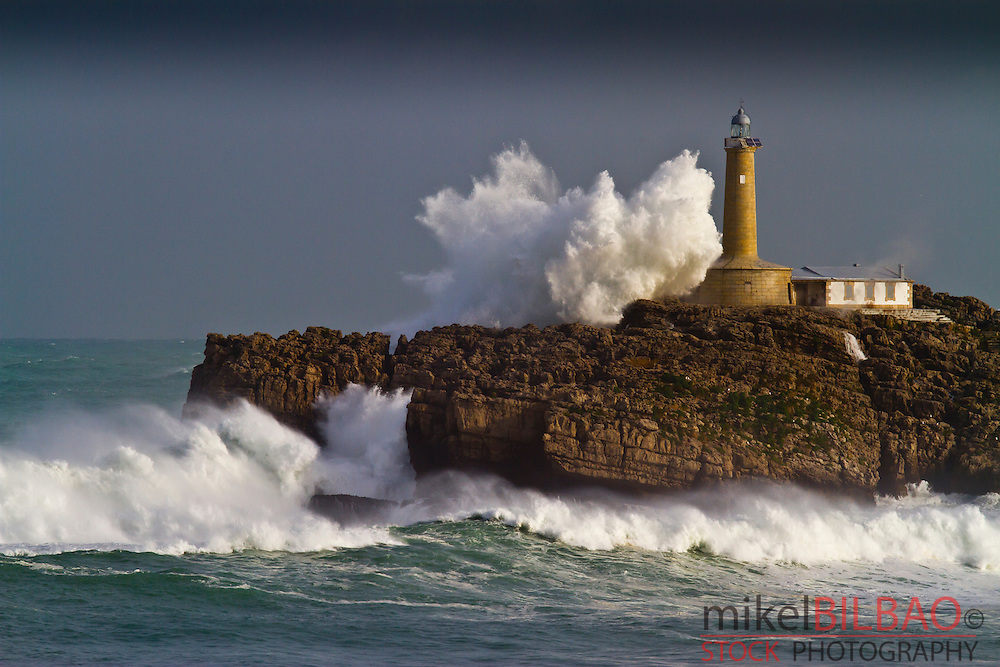 Mouro island and lighthouse in a storm. Santander. Cantabria, Spain.