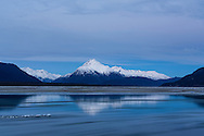 Twilight and long exposure of pancake ice flowing in the Chilkat River with the Chilkat Mountains in the Chilkat Bald Eagle Preserve in Haines in Southeast Alaska. Winter. Morning.
